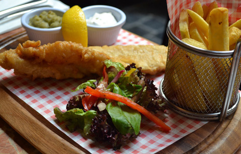 Fresh cod in batter with chips at McNeills of Howth