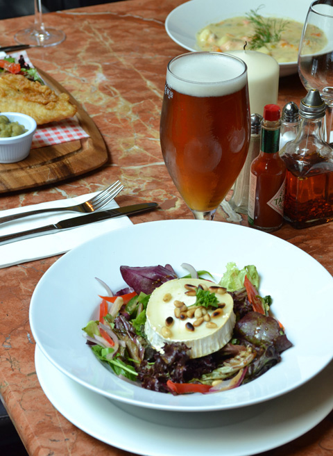 Brie salad with pine nuts with a glass of red ale at McNeills